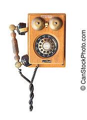 Old wood vintage telephone isolated on white background