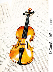 Old wood violin lying  musical notes