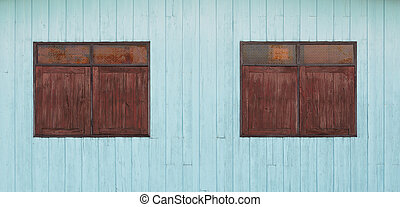 old wood window on blue wooden wall
