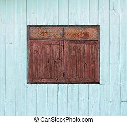 old wood window on blue wooden wall