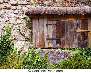 old wood window on stone wall architect, climbing plant vintage European style background