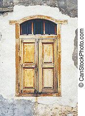 old wood windows on brick wall