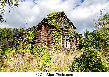 Old wooden abandoned house at the countryside
