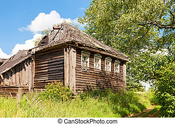 Old wooden abandoned house in russian village. Novgorod region,