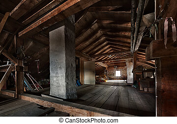 old wooden attic with roof framework structure and window