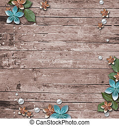 Old wooden background with a flowers, pearls