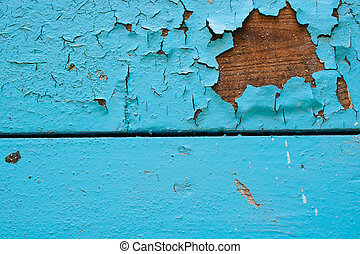 Old wooden background with blue peeling paint