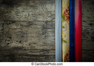 old wooden background with colored paper