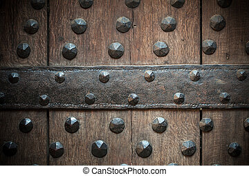 Old wooden background with metal rivets