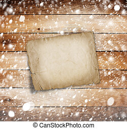 Old wooden background with snow for design