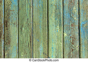 Old wooden background. Wood texture painted green closeup. Vintage wood.