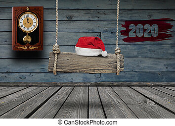 Old wooden banner with Santa hat hanging on a dark grungy room and copy space