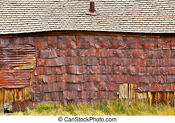 Old wooden barn detail of rusty roof and wall