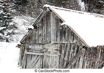 Old wooden barn in winter