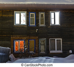old wooden barracks at winter night
