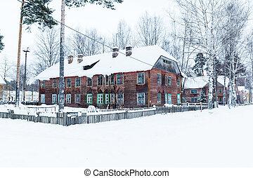 old wooden barracks at winter night