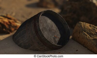 old wooden barrel at sand beach