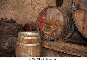 old wooden barrels for aging and storage of liquor
