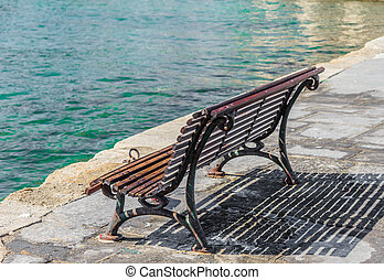 wooden bench on the promenade sea bay