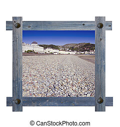 Old wooden blue frame against a white background with view ...