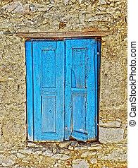 Old wooden blue window