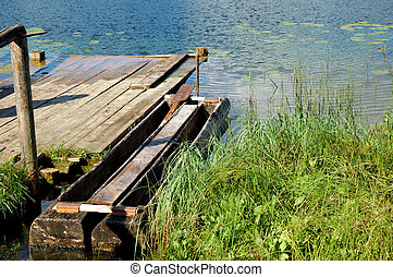 Old wooden boat at a birth
