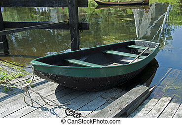 old wooden boat in the water