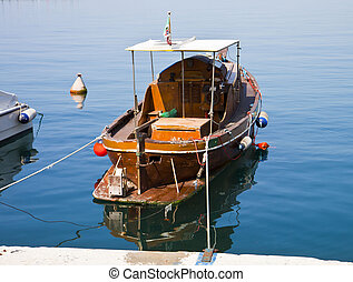 Old wooden boat moored