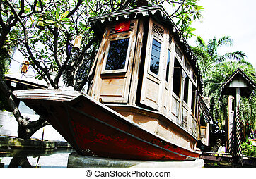Old wooden ship used to decorate the garden.