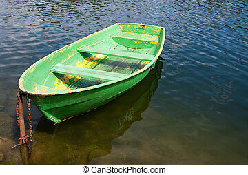 Old wooden boat on lake