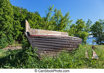 old wooden boat on the beach