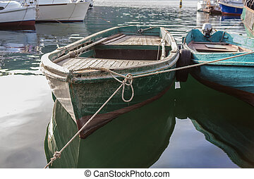 old wooden boats parked