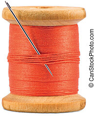 Old wooden bobbin with red thread isolated