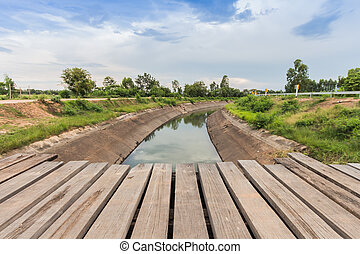 Old wooden bridge across the canal