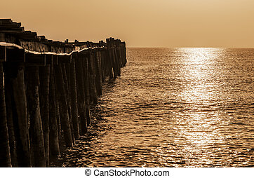 Old wooden bridge at sunrise with sepia