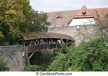 Old wooden bridge in Rothenburg