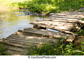old wooden bridge on the river