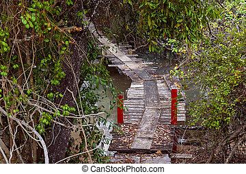 Old Wooden Bridge Over A Creek At High Tide