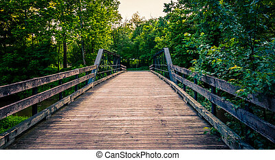 Old wooden bridge over a creek in Southern York County, Pennsylvania.