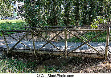 Old Wooden Bridge over a Little Creek in Portugal