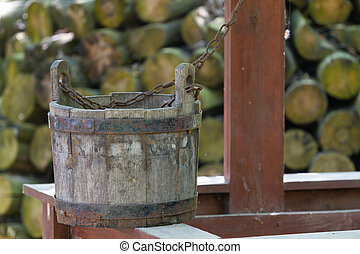 Old wooden bucket and well
