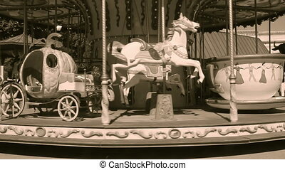 Old wooden carousel in Arles, France, sepia video
