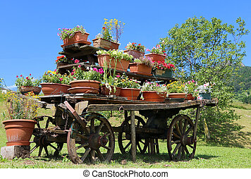 old wooden cart festooned with many flowers