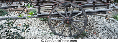 Old wooden cart on a farm in the village.