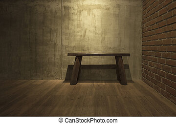 Old wooden chair on gray cement wall background.