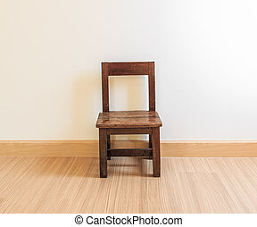 Old wooden chair on laminate flooring in the room