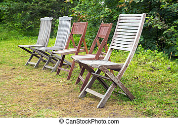 Old wooden chairs in a garden