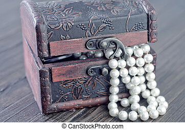 Old wooden chest with perl
