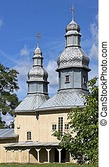 Old wooden church against the blue sky.