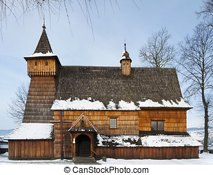 Old Wooden Church in Debno, Poland, on winter